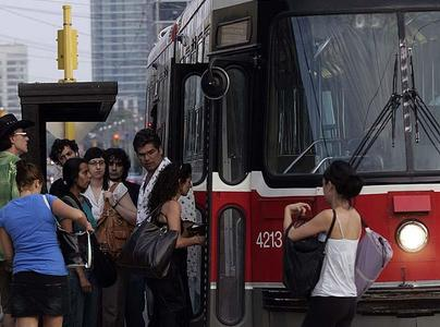 Passengers Boarding Streetcar