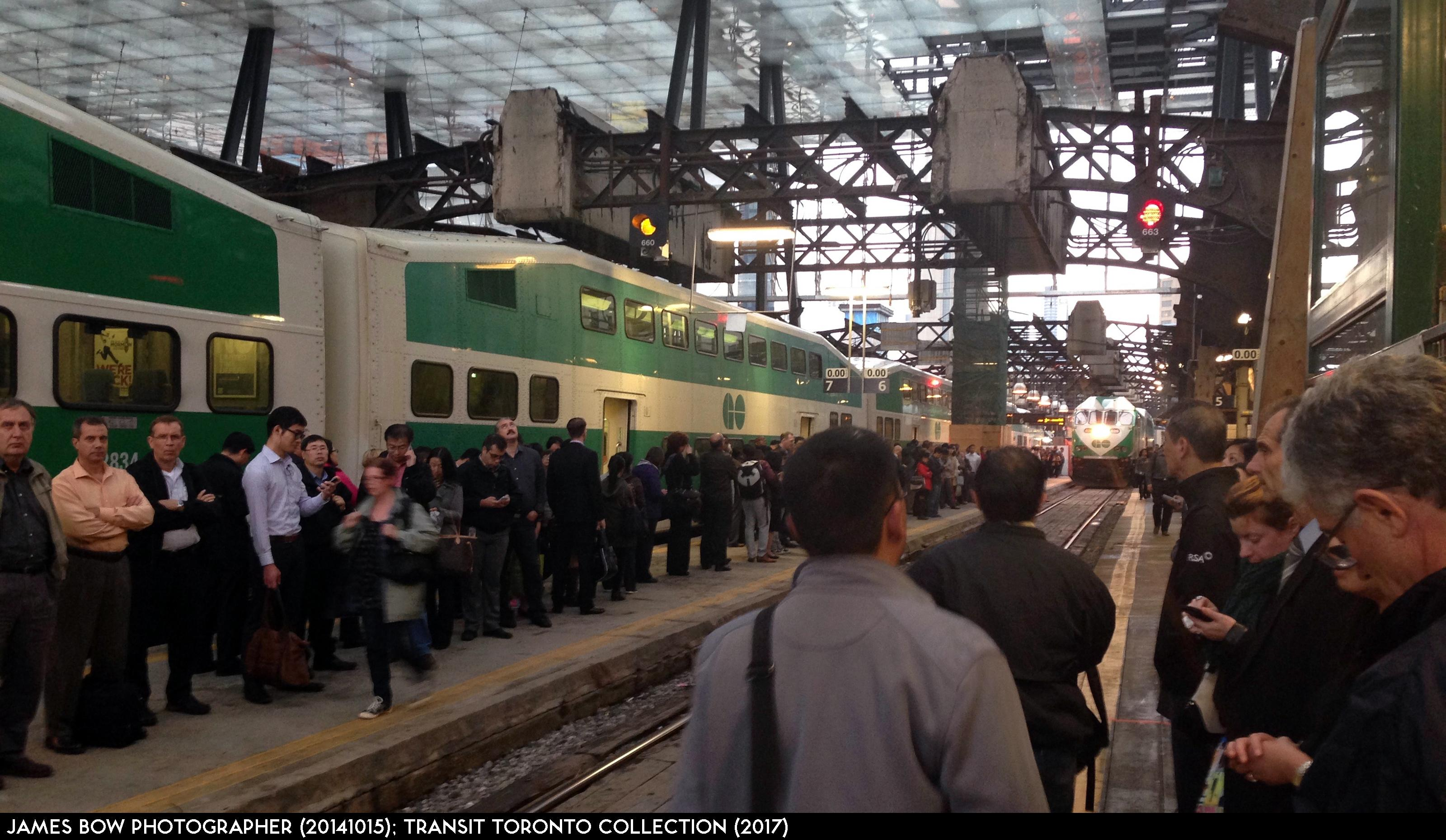 Image result for people waiting for  train in union station