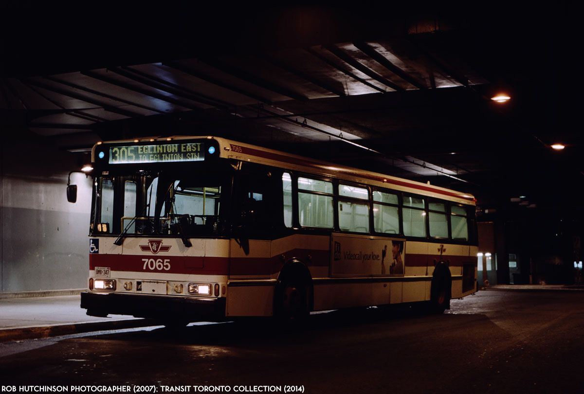 TTC Orion V bus #7065 pauses at Eglinton station's bus terminal on ...